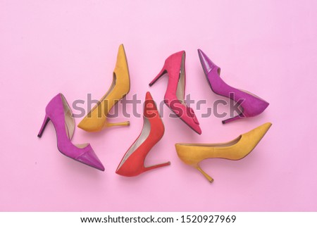 Variety of women's footwear with thin high heels, stiletto shoes on pink background    #1520927969