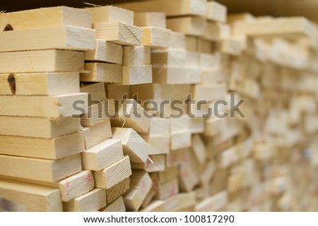 Variety of wood boards on shelf in supermarket