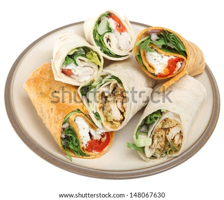 Variety of wrap sandwiches filled with chicken and cheese.