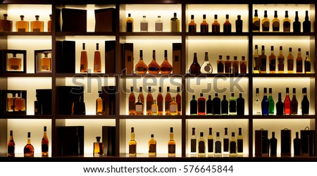 various alcohol bottles in a...