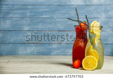 Various alcoholic cocktails on white background. Colorful cocktails close up. Fruit juice cocktail drink. assorted cocktail drinks. Glasses of fruit drinks with ice cubes on table in cafe