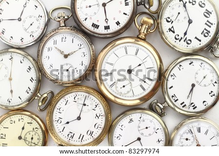 Various Antique pocket watches on white
