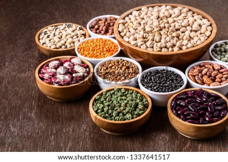 Various assortment set of indian legumes in bowls on wooden background with copyspace. Vegetable proteins. Protein products for vegans. Healthy eating concept. #1337641517