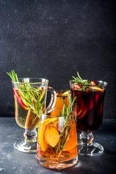 Various autumn winter alcohol drinks set. Different seasonal alcohol cocktails - mulled wine, glogg, grog, eggnog, ginger ale, hot buttered rum, punch, apple cider, sangria, white background