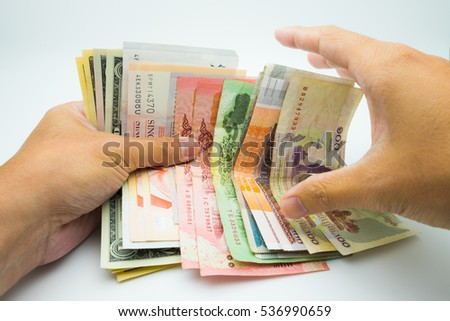 Various bank note with a hand trying to grab one #536990659