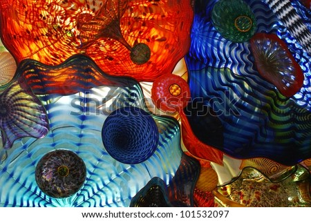 Various blown glass objects piled together to create some beautiful color and texture./ Blown Glass, A World of Color / Very beautiful example of blown glass colors. A great artistic background, or?