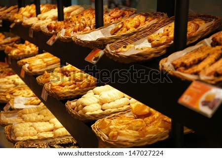 Various bread type on shelf in Bakery shop.