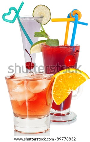 Various, bright cocktails on a white background, close up.