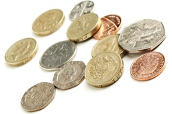 various british currency coins on white background