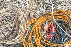 Various cable scrap as background on the subject of recycling