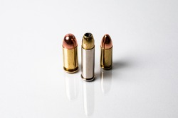 Various caliber ammunition on a white reflective background