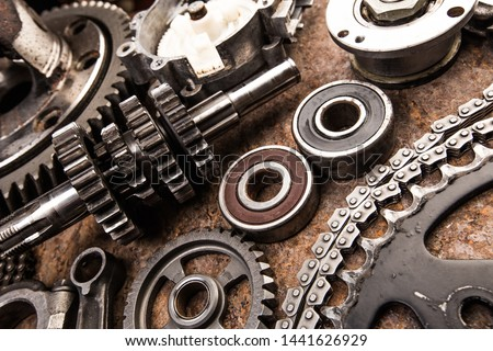 Various car parts and accessories, on metal  background