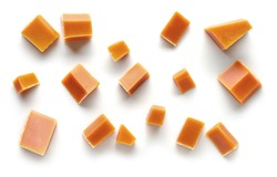 various caramel pieces isolated on white background, top view