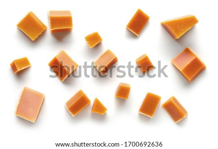 various caramel pieces isolated on white background, top view Stock photo ©
