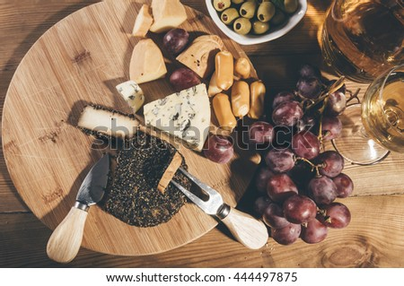 Various cheeses on the board and grapes #444497875