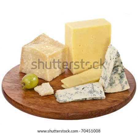 various cheeses on the wooden board isolated on white background - stock photo