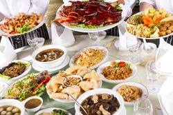 various chinese food, mixed Chinese food with chef holding some dishes