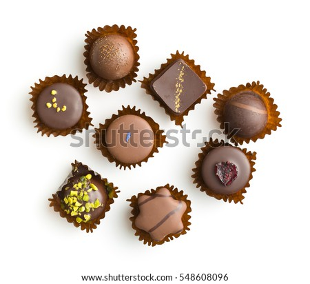 Various chocolate pralines isolated on white background. Top view. #548608096