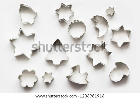 Various Christmas-themed cookie cutters.Xmas cookie cutters on white. Holiday pattern.