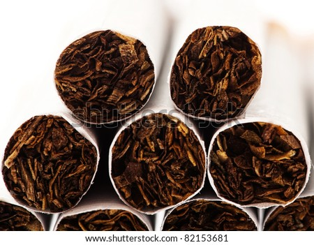 various cigarettes closeup on a white background