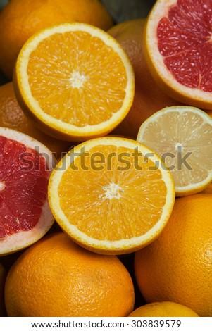 Various citrus fruits.Mixed citruses, oranges, lemon, grapefruit. Fresh citrus fruits background.