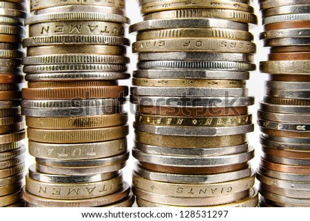 Various coins arranged in stacks shown up close