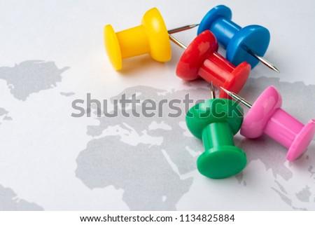 Various color of big thumbtack or pushpin ready to pin on next travel destination map. #1134825884