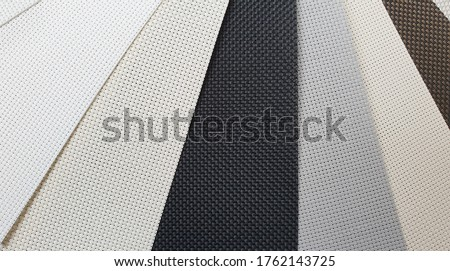 various color of roman or roller blind samples in close up view. interior material selection.