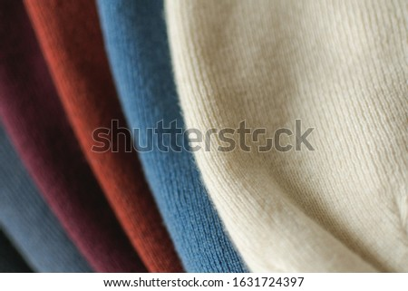 Various colored luxury wool fabrics. Woolen textile – hats. Luxury cashmere hats in white, blue, red, violet and shadow colors. Fashion for winter season. Mongolian cashmere wool. Сток-фото ©