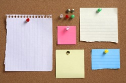Various colorful blank notes on cork board