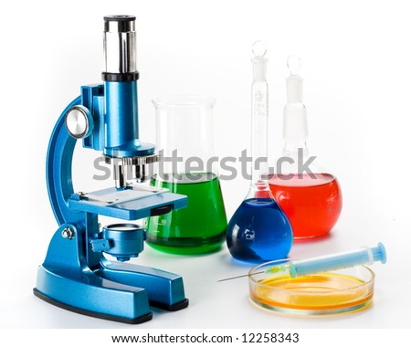 Various colorful flasks and blue microscope over white background