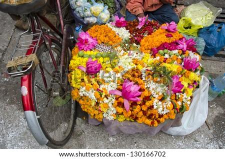 various colorful  flowers religious offerings in Varanasi street market, India