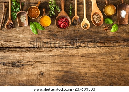 Shutterstock Various colorful herbs and spices on wooden table
