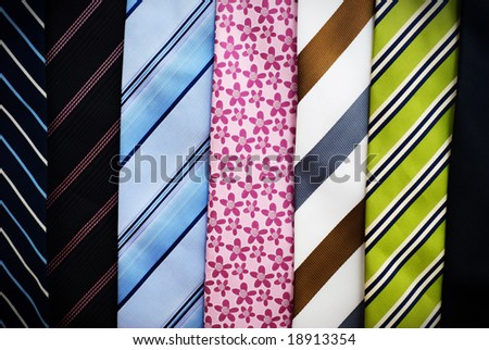 Various colorful neckties laid in a row