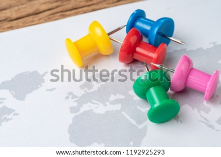 Various colorful of big thumbtack or pushpin ready to pin on next travel destination map, planning for next vacation or holiday trip. #1192925293