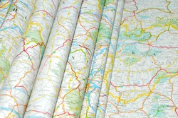 Various colorful road maps folded