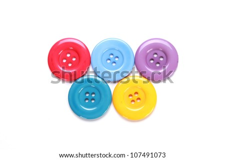 Various colorful sewing buttons on white background