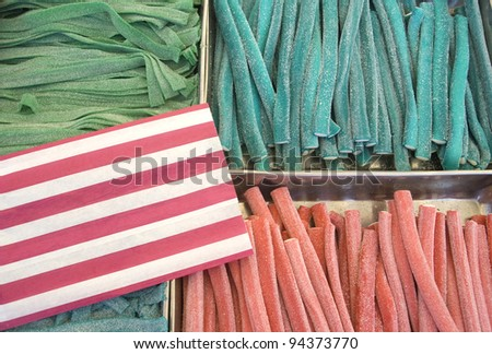 Various colour jelly sticks in a market