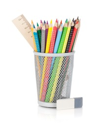 Various colour pencils with ruler and rubber. Isolated on white background