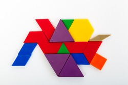 Various colourful deci pattern blocks forming interesting shapes for fun math learning
