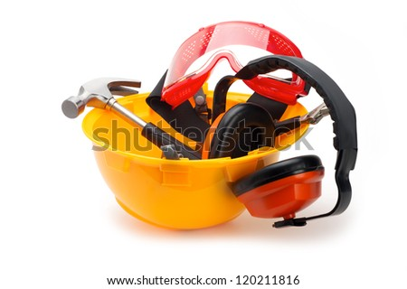 Various construction tools on yellow helmet