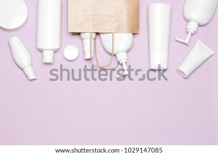 Various cosmetic products with paper packaging bag. Buying cosmetics. Beauty shopping. Copy space #1029147085