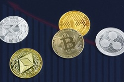 Various cryptocurrency coins on blue background. Cryptocurrency, virtual money. Virtual digital currency