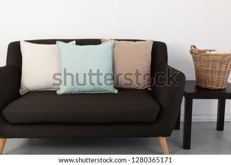 Various cushions arranged on sofa