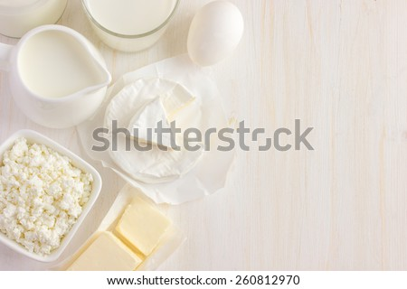 Various dairy products  on white background, top view, copy space