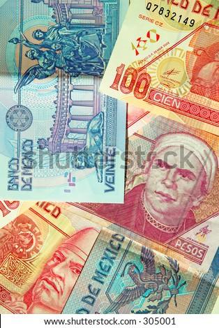 Various denominations of pesos, money from Mexico, Mexican currency.  Banco de Mexico. (macro,14MP camera) - stock photo