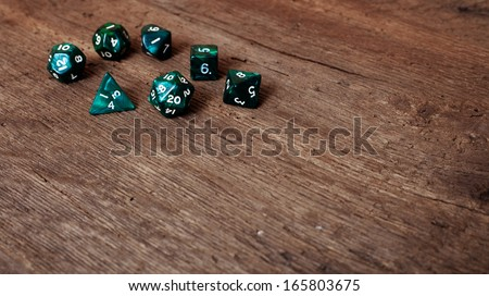 Various dices on wooden table
