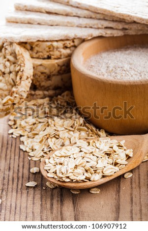 Various dietary oat products on wooden table - stock photo