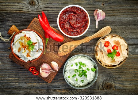 Shutterstock various dip sauces on wooden table, top view