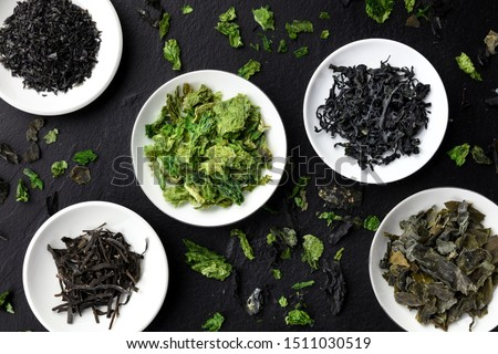 Photo of  Various dry seaweed, sea vegetables, shot from above on a black background